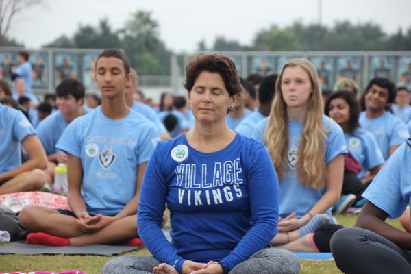 Gabriella Rowe and Village School students doing yoga